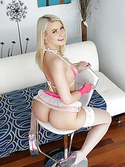 Blonde Anikka Albrite modeling the latest in stockings and panty fashions
