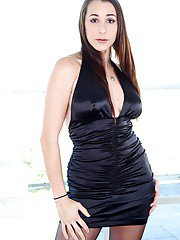 Latina solo model Kaylynn posing in hot black dress and riding crop