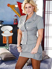 Older blonde lady Phyllisha Anne removes dress to reveal strapon cock