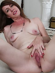 Housewife Joanie Bishop spreading hairy twat for creamy pussy viewing