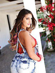 Sultry babe August Ames poses non nude outdoors in cowgirl boots and shorts