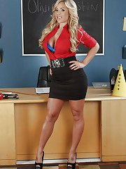 Busty blonde teacher Olivia Austin flashes panties and nice rack in class