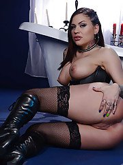Exotic babe Karmen Karma strutting shaved twat in black boots and stockings