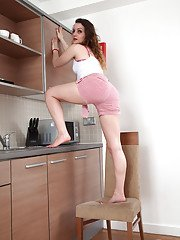 Barefoot housewife Khalisa posing with pubic hair escaping from panties