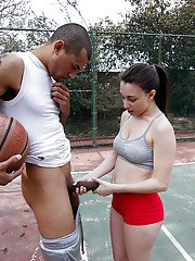 Young Latina coed Alexis Rodriguez gives blowjob to long black cock outside