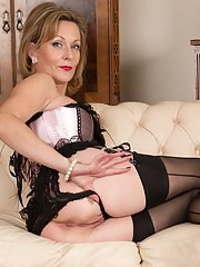 Mature blonde dame Huntingdon Smyth exposing nice tits underneath bustier