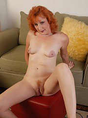 Flaming redhead Sasha showing off shapely mature legs and painted toenails