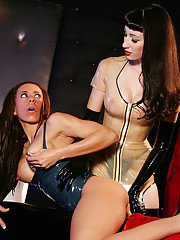 Hot latex lesbians in high heels and gloves toy each others wet cunts