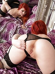 Poline the fat redhead shows off her curves in some sexy lingerie