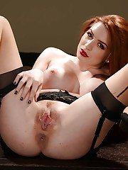 Redheaded wife Veronica Vain striking sexy solo poses in lingerie