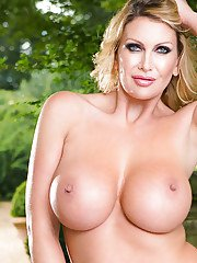 Blonde mom Leigh Darby showing off her huge boobs outdoors