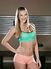 Blonde cutie Kenna James showing off toned teen figure in short shorts