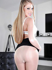 Blonde pornstar Kare Bare removing business suit and hose to pose in nude