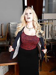 Blonde beauty Angel Wicky stripping out of office worker clothes