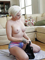 Short haired blond babe Dylan Phoenix exposes big tits and pierced nipples