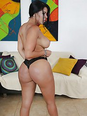 Brunette babe Diamond Kitty showing off her phat oiled Latina booty