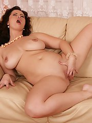 Busty mom Sirale and her large hanging tits masturbating hairless twat
