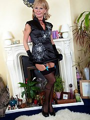 Sexy blonde granny Cathy Oakley striking solo poses in stockings and heels