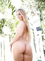 Solo chick Candice Dare posing her naked goodies in the nude outdoors