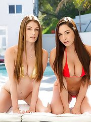 Busty beauties Dillion Carter and Karlee Grey posing outdoors in bikinis