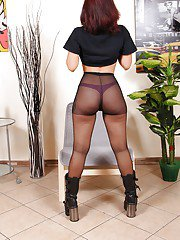 Alternative babe model Chiara posing fully clothed in black boots and hose