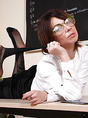 Flexible non nude teacher Lilith showing off tattoos underneath hosiery