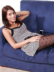 Non nude babe Petra displaying sexy polka dot stocking clad legs