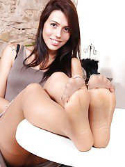 Pantyhose adorned babe Petra flashing upskirt views and bare feet