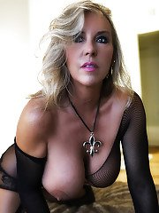 Hot older blonde housewife Sandra Otterson modelling mesh lingerie