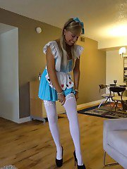 Kinky blonde housewife Sandra Otterson posing topless in white stockings