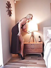 Leggy blond housewife Sandra Otterson posing topless for glamour shoot