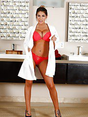 Big boobed brunette solo model August Ames posing in pink bra and panties