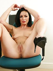 Mature MILF Roxanne Cox strips naked at office for masturbation session