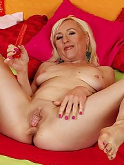 Experienced blonde woman Tina toying her shaved mature pussy with dildo
