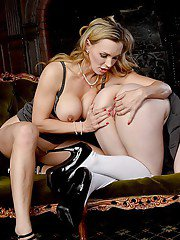 Older blonde woman teaches young brunette chick all about lesbian sex