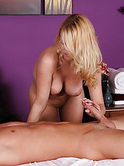 Blond masseuse Codi Carmichael giving a full body massage with happy ending