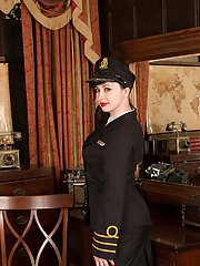 Mature MILF Nikita striking sexy glamour poses in uniform and hat