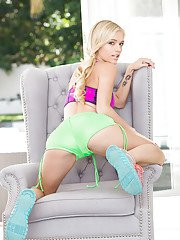 Blonde cutie Alex Grey posing non nude in shorts and sports bra outdoors