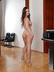 Hot French MILF modelling fully clothed in high heels skirt and blazer