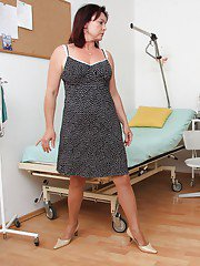 Mature woman Simi strips down to underwear an pantyhose for gyno doc