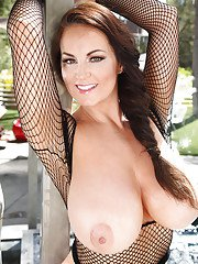 Chesty beauty Sarah Nicola Randall modeling outdoors in mesh top