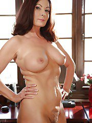 Older boss lady Magdalene St Michaels strips off skirt and hose for nudes