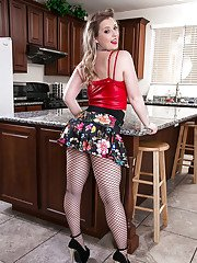 Blonde mom Sunny Lane looking like a doll in fishnet stockings
