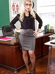 Blonde teacher Ashley Fires posing clothed in nylons skirt and glasses
