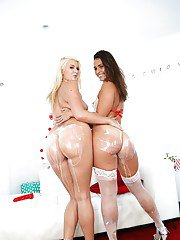 Big butt lesbians Layla Price and Kelsi Monroe pose for Christmas photos