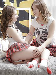 Lesbian schoolgirls Juliya and Parvin undress each other for bedroom sex