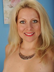 Older blonde MILF Zoey Tyler posing fully clothed before stripping nude