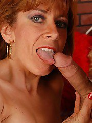 Aged redhead Mikela eats jism off of face after taking money shot