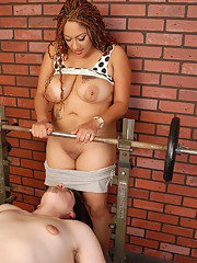 Chesty mixed race chick Silvia giving a topless blowjob in weight room