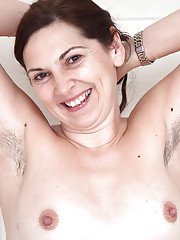 Mature all natural model Francesca display furry armpits and beaver
